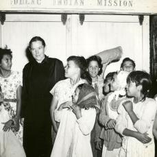 Miss Wilhelmina Hooper and school children of Dulac Indian Mission
